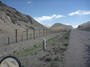 The Chinese border fence just metres from the road