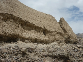 "The outer walls of original ""tashkurgan"" slowly being washed away."