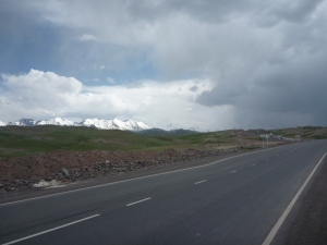 Welcome to Kyrgyzstan: perfect road, spectacular mountains - straight into a hailstorm.