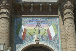 Detail from Bagh-e Melli Gate in central Tehran. Love the combination of traditional mosaics with the machine gun.