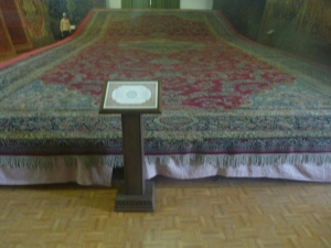 Now that's a carpet! This priceless antique carpet measures 25m by 17m. That's Sam in the upper left corner.